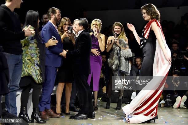 Designer Zang Toi greets Donald Trump Jr at the Zang Toi front row during New York Fashion Week The Shows at Gallery II at Spring Studios on February...