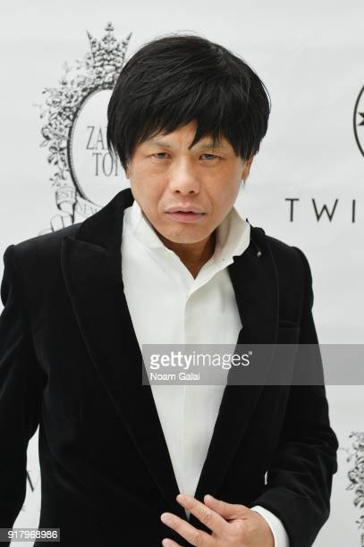 Designer Zang Toi poses backstage for Zang Toi during New York Fashion Week The Shows at Pier 59 on February 13 2018 in New York City