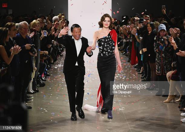 Designer Zang Toi walks the runway for the Zang Toi fashion show during New York Fashion Week The Shows at Gallery II at Spring Studios on February...
