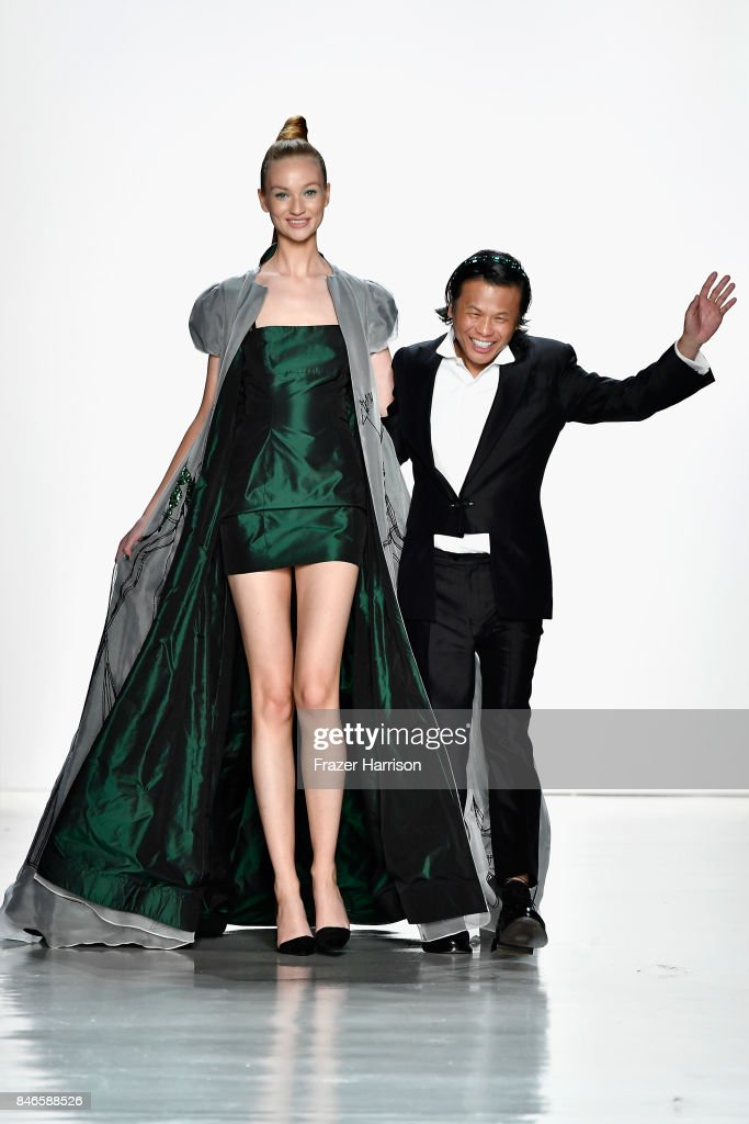 Designer Zang Toi walks the runway with a model at the Zang Toi fashion show during New York Fashion Week: The Shows at Gallery 3, Skylight Clarkson Sq on September 13, 2017 in New York City.