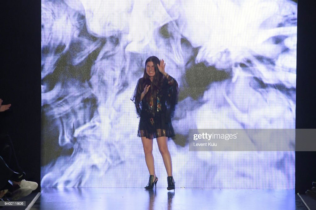 Designer Zeynep Tosun acknowledges the applause of the audience after her show during Mercedes Benz Fashion Week Istanbul at Zorlu Performance Hall on March 30, 2018 in Istanbul, Turkey.