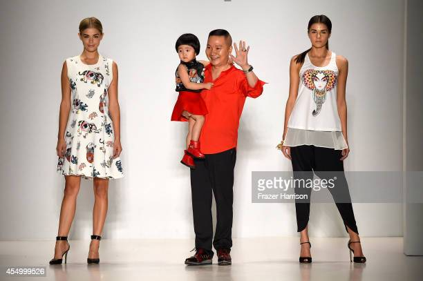 Designer Zhuliang Li appears on the runway with model Danielle Knudson and Miss Teen USA K Lee Graham at the Oudifu fashion show during MercedesBenz...