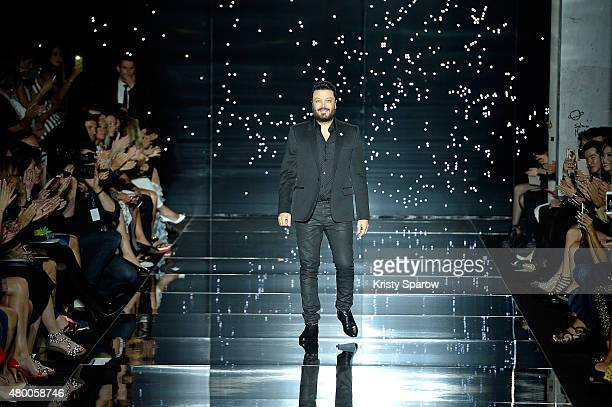 Designer Zuhair Murad acknowledges the audience during the Zuhair Murad show as part of Paris Fashion Week Haute Couture Fall/Winter 2015/2016 on...