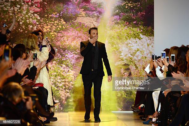 Designer Zuhair Murad acknowlegdes the applause of the audience after the Zuhair Murad Prive show as part of Paris Fashion Week Haute Couture...