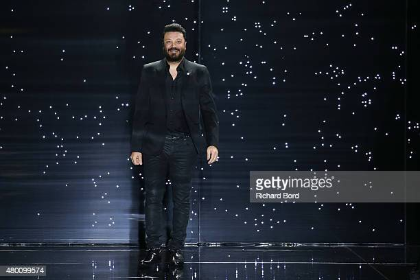 Designer Zuhair Murad ackowledges the audience during the Zuhair Murad show as part of Paris Fashion Week Haute Couture Fall/Winter 2015/2016 on July...