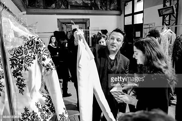 Designer Zuhair Murad backstage before his show as part of Paris Fashion Week HauteCouture Spring/Summer 2014 at Palais des BeauxArts on January 23...