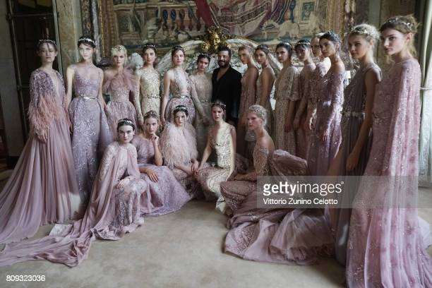 Designer Zuhair Murad poses with models after the Zuhair Murad Haute Couture Fall/Winter 20172018 show as part of Haute Couture Paris Fashion Week on...