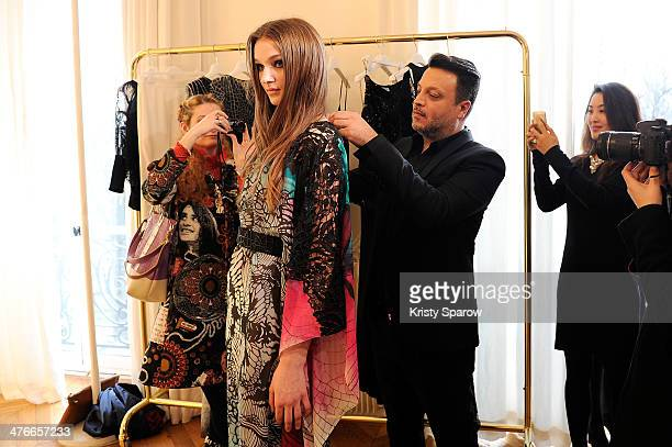 Designer Zuhair Murad prepares a model during his presentation as part of Paris Fashion Week Womenswear Fall/Winter 20142015 on March 4 2014 in Paris...