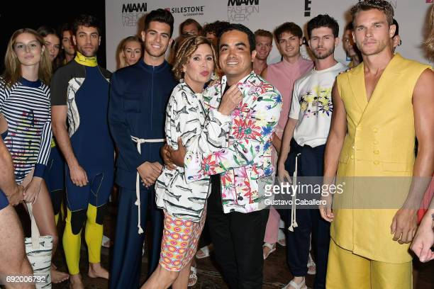 Designers Agatha Ruiz De La Prada and Yirko Sivirich pose backstage at the Yirko Sivirich Show during Miami Fashion Week at Ice Palace Film Studios...