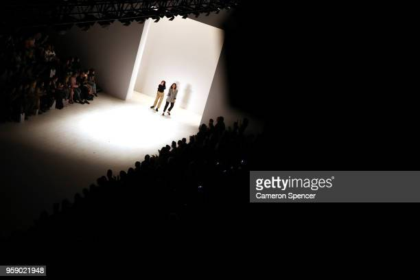 Designers Alexandra Nguyen and Mary Quach thank the audience following the AM show during the Raffles International Showcase show at MercedesBenz...