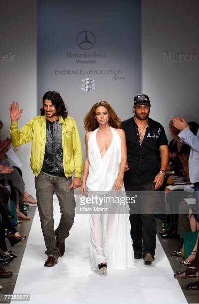 Designers Ali Alborzi and Andrew McCarthy walk the runway with a model at the Evidence Of Evolution Spring 2008 fashion show during Mercedes Benz...