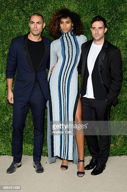 Designers and finalists Scott Studenberg and John Targon of Baja East pose with model Imaan Hammam at the 12th annual CFDA/Vogue Fashion Fund Awards...