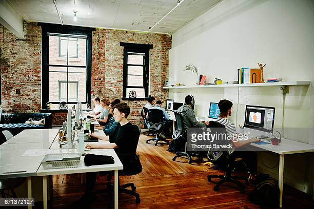 Designers and programmers working in office