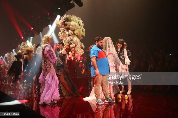 Designers Anna Plunkett and Luke Sales thank the audience during the Romance Was Born show at MercedesBenz Fashion Week Resort 18 Collections at...