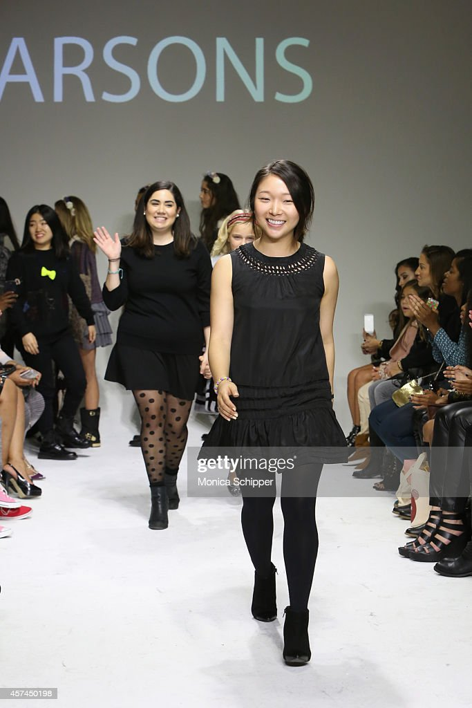Designers Ashley Chang (R) and Danielle Molina (L) walk the runway with models during the Parsons preview at petitePARADE / Kids Fashion Week at Bathhouse Studios on October 18, 2014 in New York City.