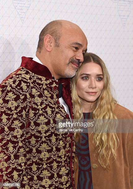 Designers Ashley Olsen and Christian Louboutin attend Louis Vuitton Monogram celebration at Museum of Modern Art on November 7 2014 in New York City