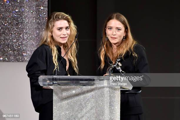 Designers Ashley Olsen and Mary-Kate Olsen accept the 2018 CFDA Accessories Designer of The Year award during the 2018 CFDA Fashion Awards at...