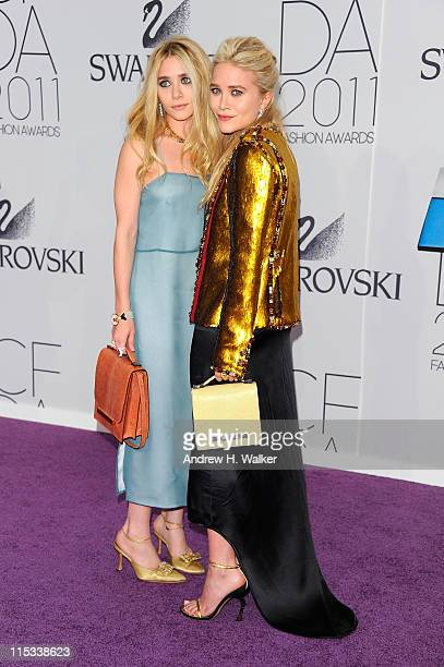 Designers Ashley Olsen and MaryKate Olsen attend the 2011 CFDA Fashion Awards at Alice Tully Hall Lincoln Center on June 6 2011 in New York City