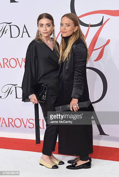 Designers Ashley Olsen and MaryKate Olsen attend the 2015 CFDA Fashion Awards at Alice Tully Hall at Lincoln Center on June 1 2015 in New York City