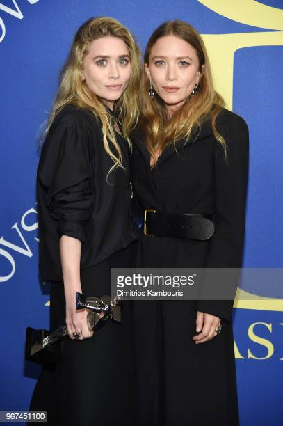 Designers Ashley Olsen and MaryKate Olsen pose with 2018 CFDA Accessories Designer of The Year award during the 2018 CFDA Fashion Awards Winners Walk...