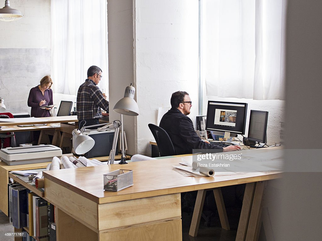 Designers at work at workstations : Stock Photo