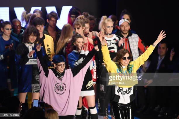 Designers Begum Berdan and Deniz Berdan acknowledgs the applause of the audience after the DB Berdan show during Mercedes Benz Fashion Week Istanbul...