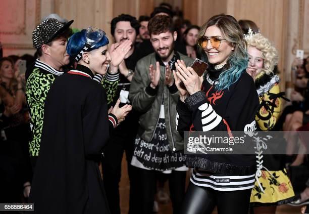 Designers Begum Berdan and Deniz Berdan R on the runway at the MercedesBenz Presents DB Berdan show during MercedesBenz Istanbul Fashion Week March...