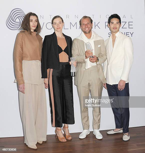 Designers Bianca Spender and Patrick Johnson pose with models after winning the Australian International Woolmark Prize for menswear and womenswear...