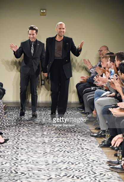 Designers Brian Wolk and Claude Morais take a bow after the Wolk Morais Collection 6 Fashion Show at The Hollywood Roosevelt Hotel on January 17 2018...