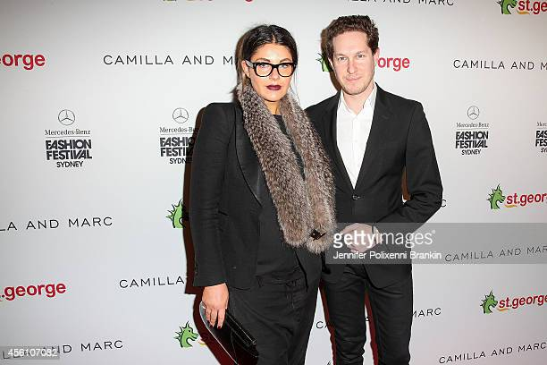 Designers Camilla FreemanTopper and Marc Freeman arrive for the Camilla and Marc St George show during MercedesBenz Fashion Festival Sydney at Sydney...