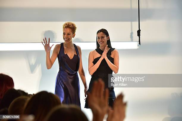 Designers Carlie Cushnie and Michelle Ochs acknowledge the crowd after end of the Cushnie et Ochs show during Fall 2016 New York Fashion Week The...