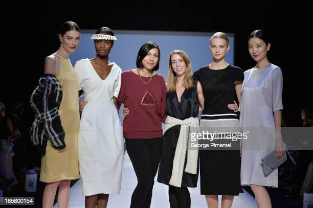 Designers Cecile Raizonville of Matiere Noire and Malorie Urbanovitch winners of of the MercedesBenz StartUp national final pose on the runway during...