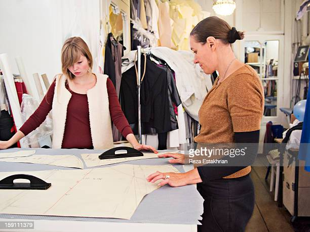 Designers consult on garment pattern