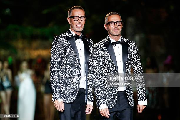 Designers Dan and Dean Caten aknowledge the applause of the audience on the runway at the DSquared2 show as a part of Milan Fashion Week Womenswear...