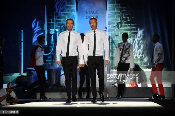 Designers Dan and Dean Caten aknowledges the applause of the public after the DSquared2 fashion show as part of Milan Fashion Week Menswear...