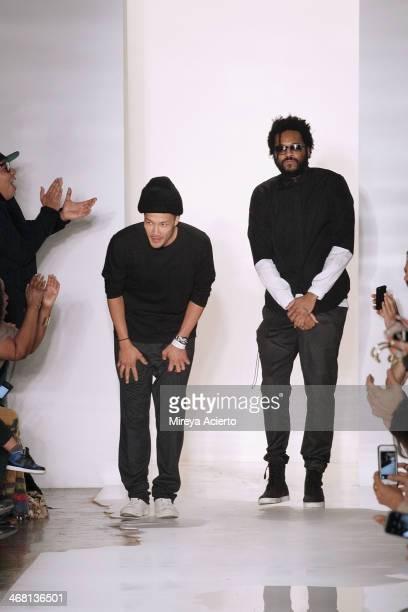 Designers DaoYi Chow and Maxwell Osborne walk the runway at the Public School fashion show during MADE Fashion Week Fall 2014 at Milk Studios on...
