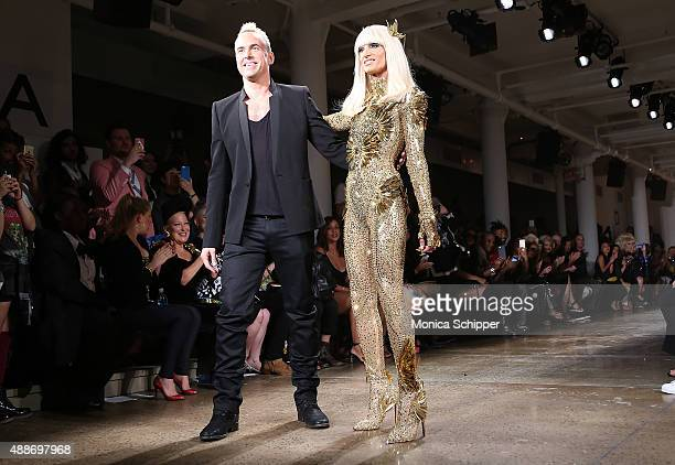 Designers David Blond and Phillipe Blond walk the runway at The Blonds fashion show during Spring 2016 MADE Fashion Week at Milk Studios on September...