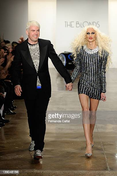 Designers David Blonde and Phillipe Blond walk the runway at the The Blonds Fall 2012 fashion show during Mercedes-Benz Fashion Week at Milk Studios...