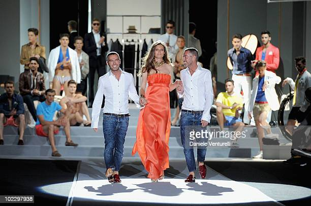 Designers Dean and Dan with Bianca Balti acknowledges the applause of the public after the DSquared2 Milan Fashion Week Menswear Spring/Summer 2011...