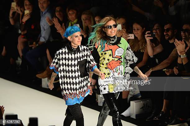 Designers Deniz Berdan and Begum Berdan are applauded walks the runway at the DB Berdan show during MercedesBenz Fashion Week Istanbul at Zorlu...