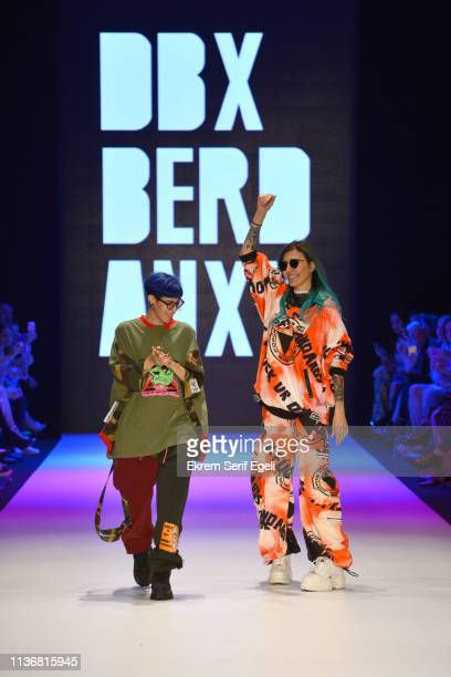 Designers Deniz Berdan and Begum Berdan walk the runway after the DB Berdan show during MercedesBenz Istanbul Fashion Week at the Zorlu Performance...