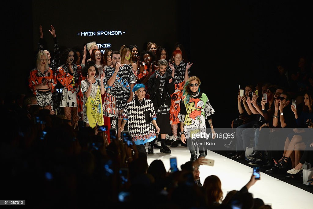 Designers, Deniz Berdan (R), Begum Berdan and modelds are applauded walks the runway at the DB Berdan show during Mercedes-Benz Fashion Week Istanbul at Zorlu Center on October 13, 2016 in Istanbul, Turkey.