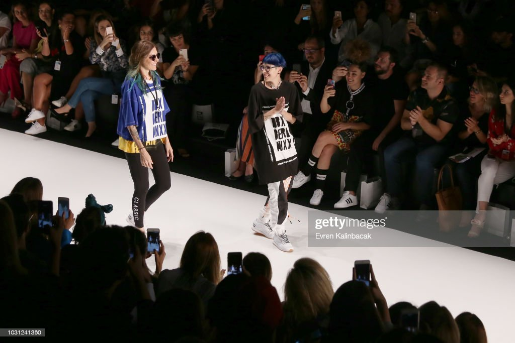 Designers Deniz Berdana And Begum Berdan Walk The Runway At The DB Berdan  Show During The