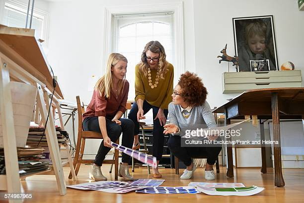Designers discussing project in office
