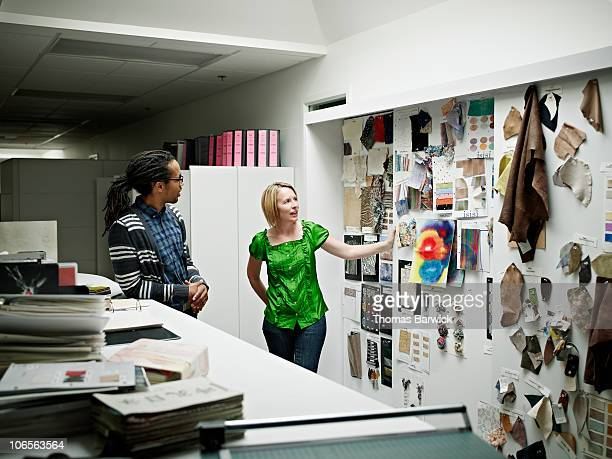 Designers discussing sample swatches