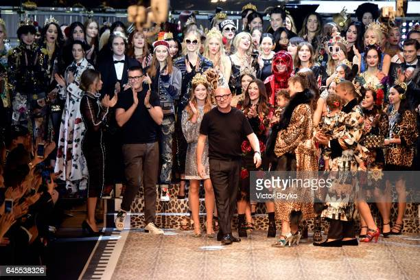 Designers Domenico Dolce and Stefano Gabbana step on to the runway at the Dolce Gabbana show during Milan Fashion Week Fall/Winter 2017/18 on...