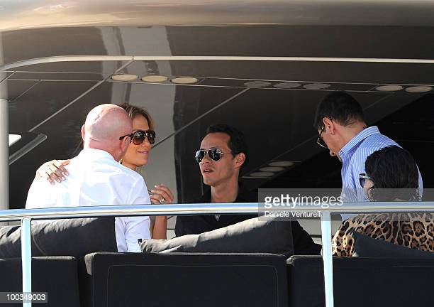 Designers Domenico Dolce and Stefano Gabbana talk with Marc Anthony and Jennifer Lopez during the 63rd Cannes Film Festival on May 23 2010 in Cannes...