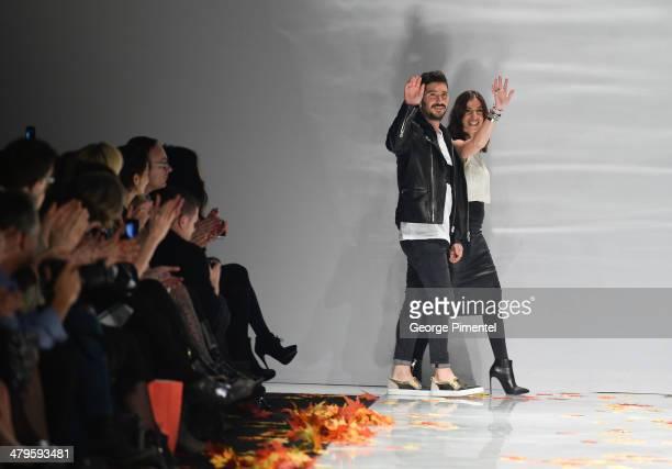 Designers Eran Elfassy and Elisa Dahan present Mackage fall 2014 collection during World MasterCard Fashion Week Fall 2014 at David Pecaut Square on...