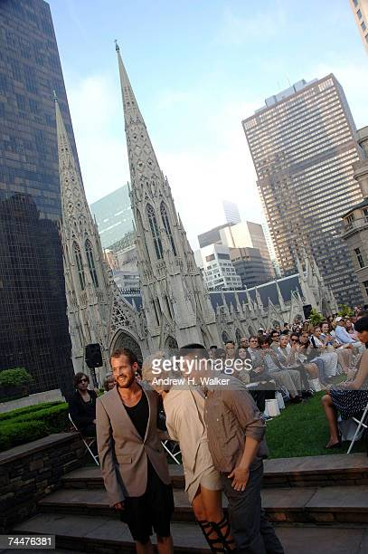 FORM designers Eric Werner Kelly Andrews and Jerry Tam pose for photographers at the FORM PreSpring 2008 Presentation with St Patrick's Cathedral in...