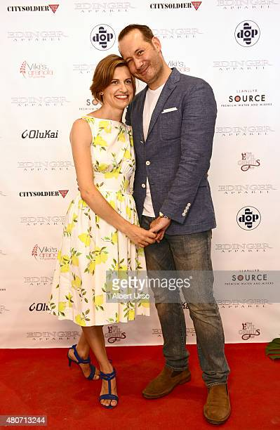 Designers Erik Nelson and Emily Cummings pose on the red carpet at the Edinger Apparel presentation during New York Fashion Week Men's SS16 at Rogue...